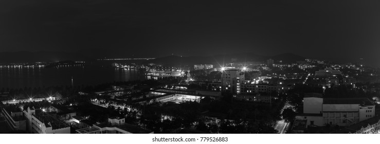 Night panoramic landscape of Dadunhai Bay and the streets next to it in Sanya City on Hainan Island - black and white