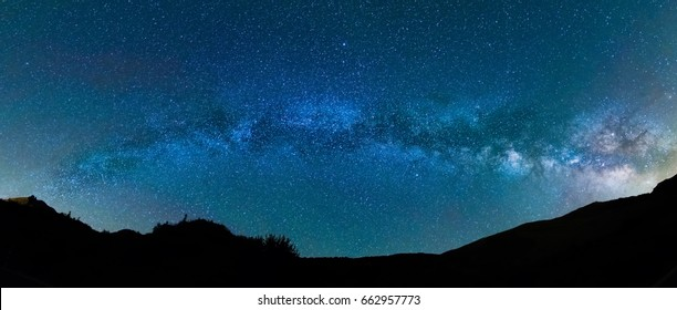 Night panoramic photography: The Milky Way over Pyrenees within Vall de Boí, Catalunya, Spain