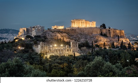 Night panoramic view of Acropolis, Athens, Greece. Famous Acropolis hill is the main landmark of Athens. Beautiful scenery of old Athens in evening. Ancient Greek ruins in the Athens center at dusk.