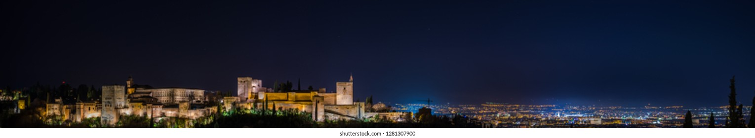 Night panoramic view of the Alhambra in Granada from the viewpoint of San Nicolas, Granada, Spain.
