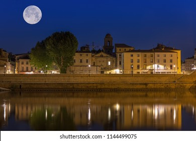Night panoramic view of the French city of Arles on the River Rhône.