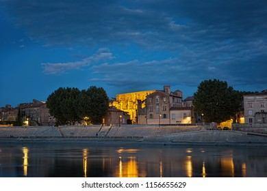 Night panoramic view of the French city of Arles on the River Rhône. Provence. France.