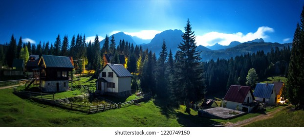 Night panoramic view of idyllic mountain scenery with traditional chalets. Žabljak, Durmitor, Montenegro