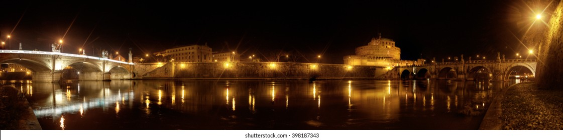 Night panoramic view of Saint Angel castle and bridge over the Tiber river in Rome, Italy. January, 2014