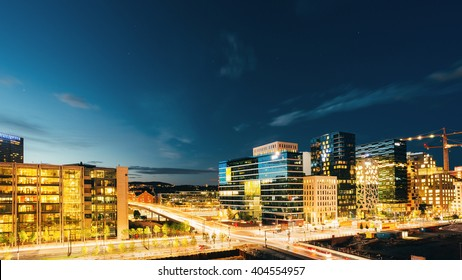 Night Panoramic View Of Street In The City Centers In Oslo, Norway. Summer Evening. Twilight, Day To Night. Construction Of Skyscrapers. Night Panorama