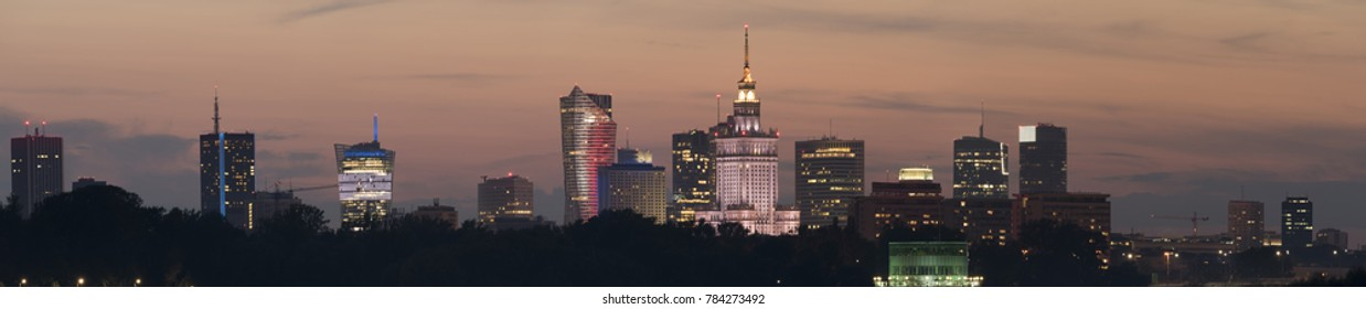 Night panoramic view of Warsaw skyline during summer day.