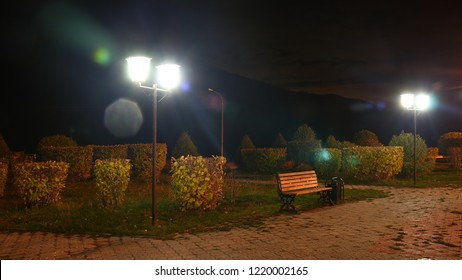 Night Park. Street lamp and bench.