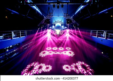 night party rave concert stage with pink lasers