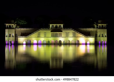 Night photo of a castle in India reflecting in the lake