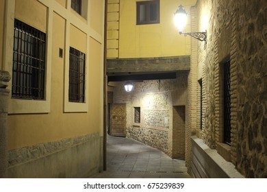Night photo of famous passageway with dwellings or dependencies on it, that forms part of the series of medieval sheds of  streets of Toledo, in  ancient building of this city, a world heritage site,