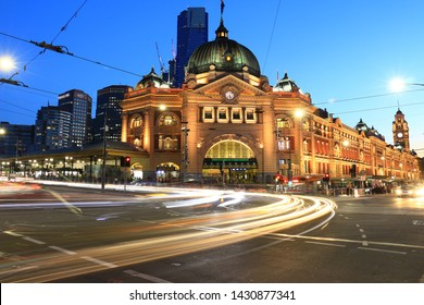 Night photo of Melbourne's iconic train station with light trails of vehicle taken by long exposure. Finders station Melbourne, Australia night photo.