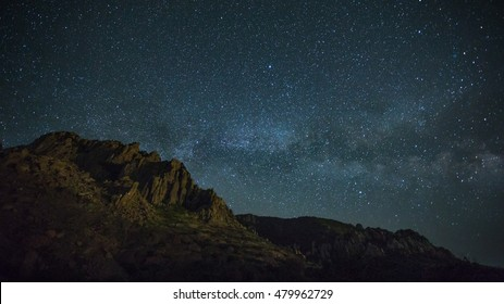 night photo of the mountains, Milky Way over the sea, the starry sky