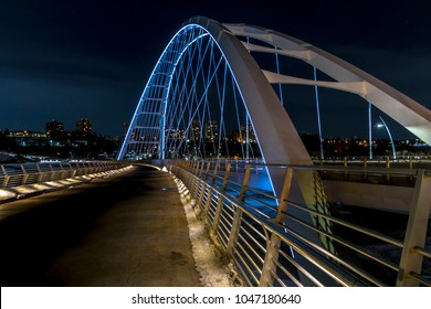 Night photo of the new Walterdale Bridge in Edmonton, Alberta.
