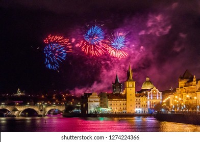 Night photo of New Year Firework 2019 in Prague. Beautiful lightshow with Charles Bridge in background at the center of Prague