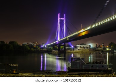 A night photograph of the railway bridge connecting the old and new part of Belgrade.