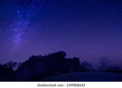 Night photography of Doi Hua Singh top of Doi Samur Dao under the stars, Sri Nan National Park, Nan, Thailand.