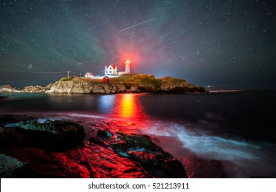 Night photography at Nubble Lighthouse. Beautiful shot with stars and a green haze.