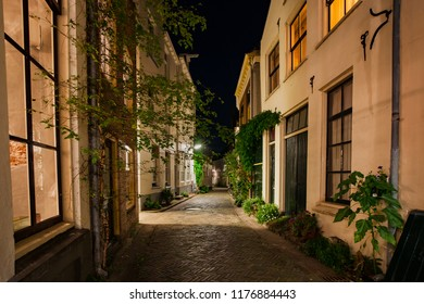 Night photography of the old hanseatic town of Zutphen at the river 'IJssel'. Monumental medieval center with atmospheric streets and beautiful architecture.