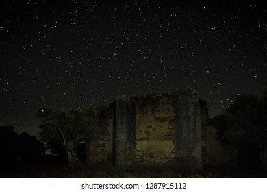 Night photography with the ruins of an ancient hermitage located near Guijo de Granadilla. Ermita de Hojaranzo. Extremadura, Spain.