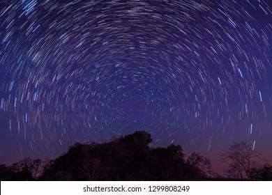 Night photography of Star-Trails above Doi Hua Singh top of Doi Samur Dao, Sri Nan National Park, Nan, Thailand.