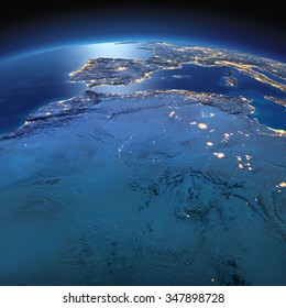 Night planet Earth with precise detailed relief and city lights illuminated by moonlight. North Africa. Algeria, Morocco and Tunisia. Elements of this image furnished by NASA
