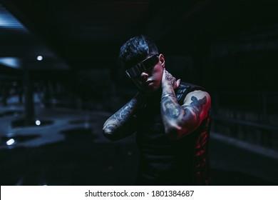 Night portrait of a man in futuristic glasses. A new trend of cyberpunk. High quality photo