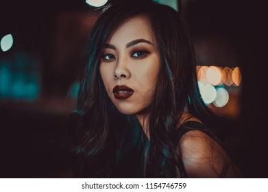 Night portrait of young asian woman