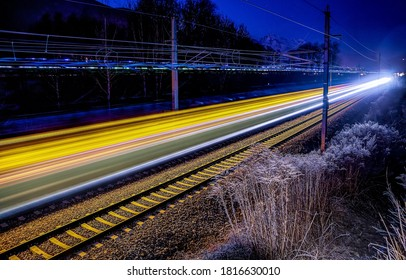 Night railway lights scene. Railroad in night lights. Railway at night. Night railway lights