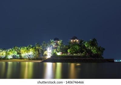 Night reflections at Palawan Island in Sentosa, Singapore
