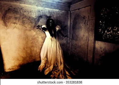 Night of the Revenge,Ghost in Haunted House,Mysterious Woman in White Dress Standing in Abandon Building,Horror Background For Halloween Concept and Book Cover Ideas