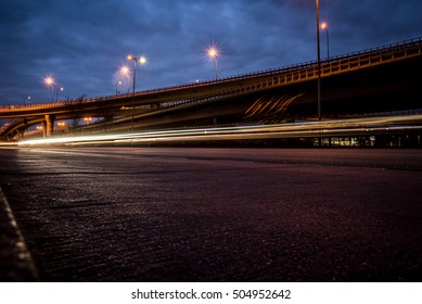 Night road in the city with car the light trails