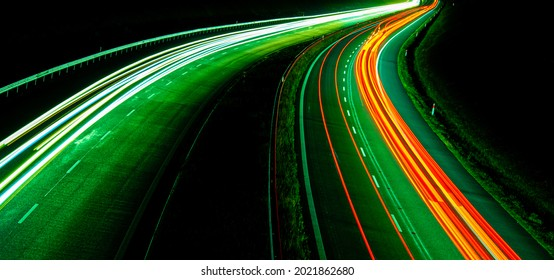 Night road lights. Lights of moving cars at night. long exposure red, blue, green, orange.
