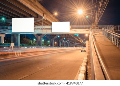 Night road long exposure with blank billboard for advertisement in Bangkok Thailand , process in vintage style
