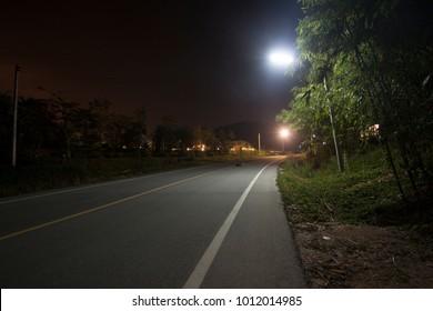 Night road at Phu Nang Yong Sam Nak Thon, Ban Chang District, Rayong Thailand.