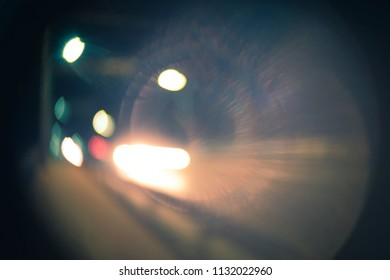 Night Road with street and car lights defocused, harsh vignette