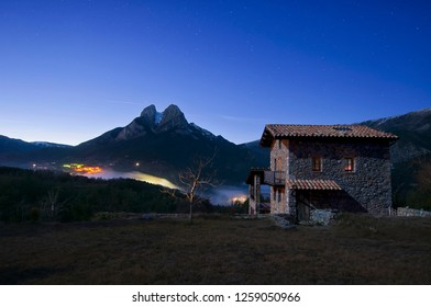 Night at Saldes, a small village from Berguedà (Barcelona). Behind a nice stone house, we can see Pedraforca, one of the most well-known mountains of Catalonia.