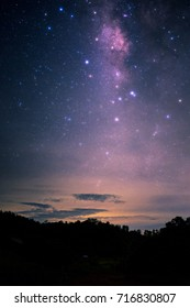 Night scape with beautiful colorful milky way and yellow sunset light. Space background. stary sky at the mountain.