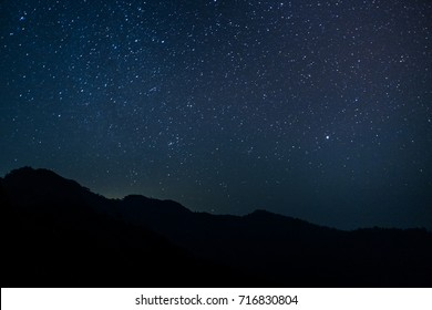 Night scape with beautiful stary sky at the high mountain.. Space background.