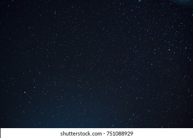 Night scape with beautiful stary sky at the high mountain. Star texture. Space background.  - Shutterstock ID 751088929