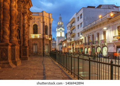 Night scene along Garcia Moreno street in Quito, Ecuador featuring Quito Cathedral and part of the Church of Jesuits.