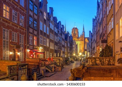 Night scene along the historical Mariacka Street in Gdansk, Poland towered by the St Mary Church (Basilica of the Assumption of the Blessed Virgin Mary).