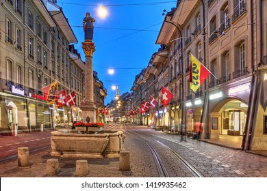 Night scene along Marktgasse (Market Street) in the old town of Bern (Berne, Berna), Switzerland
