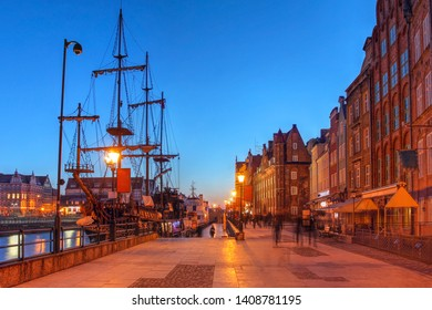 Night scene along the quai in Gdansk (Danzig), Poland, featuring the Black Pearl, a historical ship permanently moored in the city.