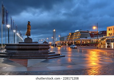 Night scene along the waterfront promenade in the resort-town of Noordwijk, The Netherlands during a stormy evening.
