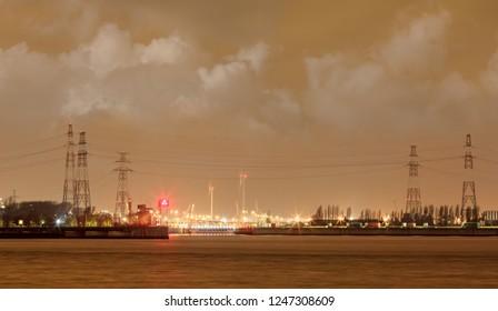 Night scene Antwerp Port with illuminated container terminal, Belgium.