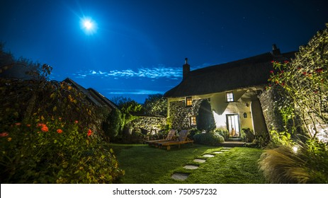 Night Scene with Bright Moon in Garden of British Cottage in English Countryside