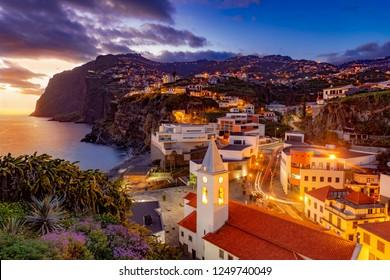 Night scene of Camare de Lobos, illuminated architecture of the town, Madeira island, Portugal