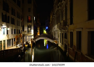 night scene with canals and bridges in Venice, Italy