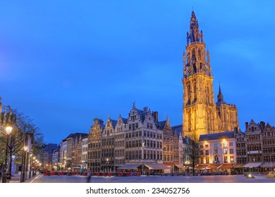 Night scene in downtown Antwerp, Belgium along the famous Meir Street and the lonely tower of the  Cathedral of our Lady.