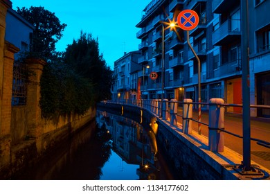 night scene with european street and water canal